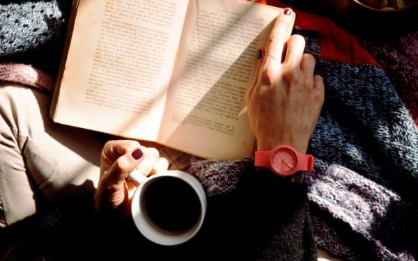 person-reading-book-and-holding-coffee-1550648-scaled-2-1024x683
